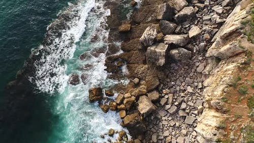 Aerial View of Cliffs Coastline with Agitated Sea