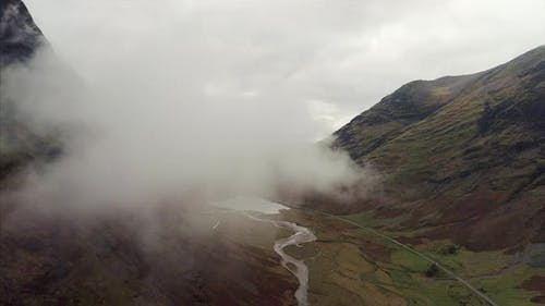 Aerial of a Stream and The Three Sisters of Glencoe Scotland