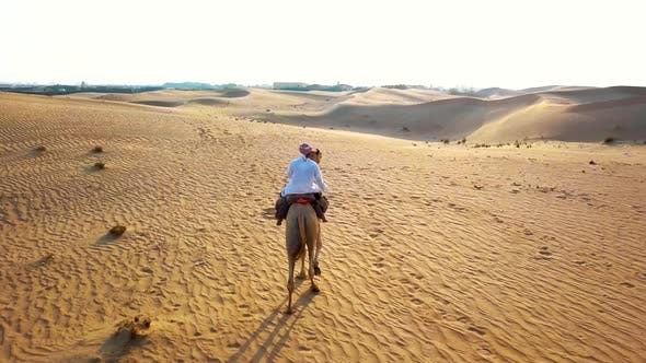 Thumbnail for Aerial Survey Drone Flies Over Bedouin, Which Goes Through the Desert