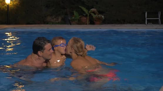 Parents and son bathing in the pool