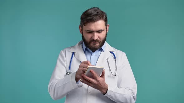 Doctor Man Records the Patient's Symptoms in His Notebook