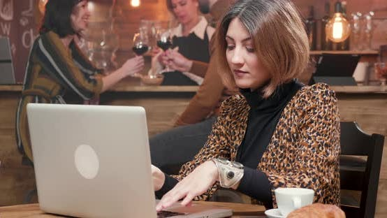 Thumbnail for Woman Entrepreneur Typing a Text on Her Laptop While Working in a Coffee Shop