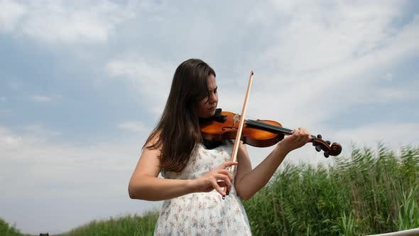 Thumbnail for Woman Playing Violin in Nature