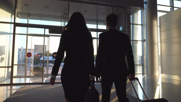 Thumbnail for Business Man and Woman with Luggage Going From the Airport To City Street