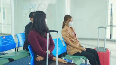 Social distancing, Airline passenger wear protective mask, keep distance away to prevent from Covid.