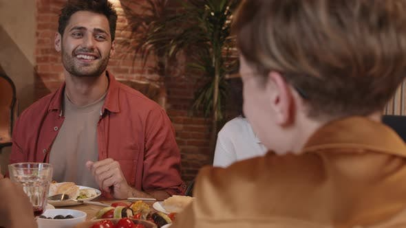 Cover Image for Cheerful Young People Talking in Restaurant