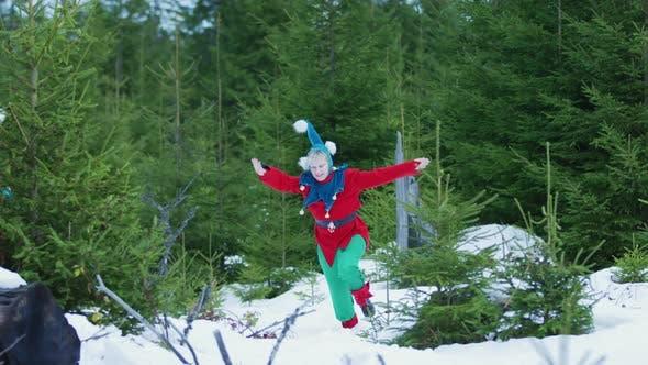 Thumbnail for Christmas elves running in the woods