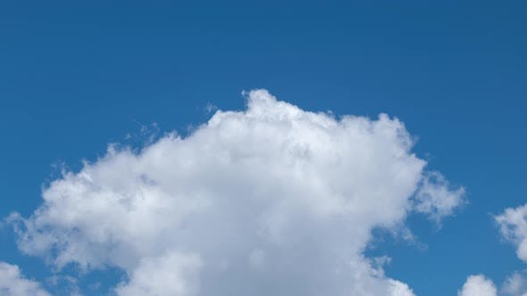 Fluffy White Clouds Moving Fast in Time-lapse. Daylight, Cloudy Heaven Background. Timelapse of