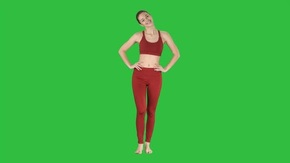 Thumbnail for Mature woman stretching her neck and walking on a Green