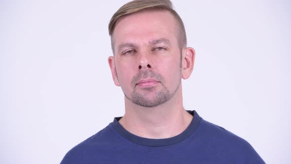 Thumbnail for Head Shot of Blonde Man Wearing Blue Shirt Against White Background