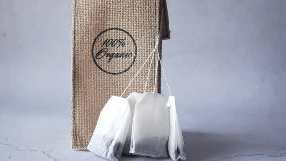Organic Tea Bag with Small Bag on Table Close Up
