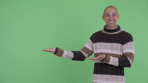 Thumbnail for Happy Bald Multi Ethnic Man Showing Something