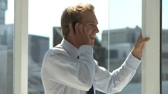 Thumbnail for MCU OF A BUSINESSMAN USING A CELL PHONE