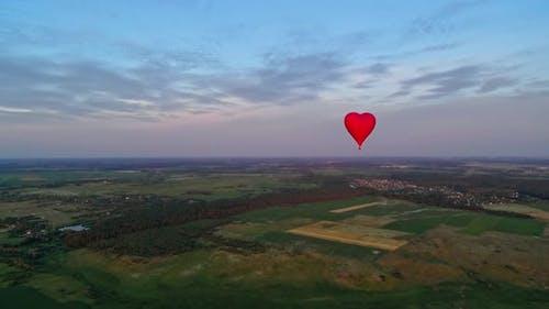 Red air balloon in love heart shape