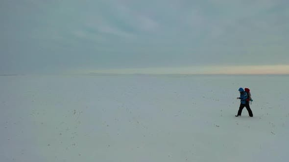 Thumbnail for Lonely Human Walk Throw Snowy Desert
