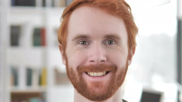Thumbnail for Smiling Face of Casual Redhead Man
