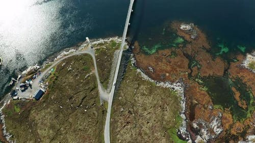 Scenic Aerial Footage of Beautiful Road with Bridge on the Island Smola, Norway