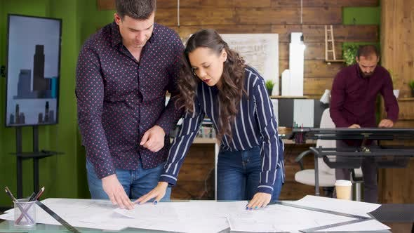 Female Architect Talking with Her Builder for a New House Project