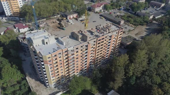 Thumbnail for Apartment building under construction in a city