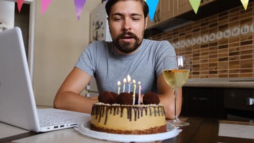 Man Blowing Out the Candle on the Birthday Cake and Making Video Call