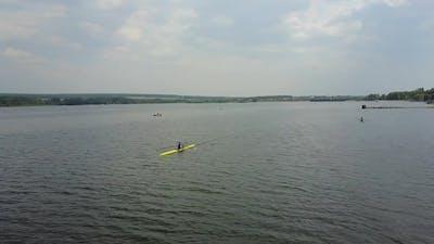 Athletes Training On Kayaks. Group of young athletes training for whitewater rafting