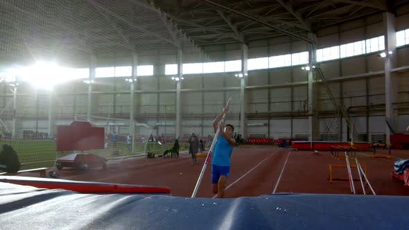 Thumbnail for Pole Vaulting - Young Sportsman in Blue t Shirt Is Running and Jumping Over the Bar