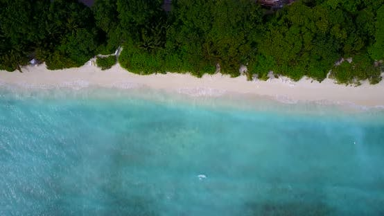 Thumbnail for Wide angle overhead travel shot of a paradise sunny white sand beach and turquoise sea background in