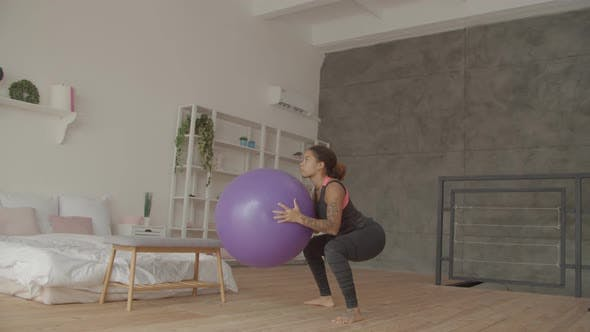 Thumbnail for African American Woman Doing Squat with Fitball