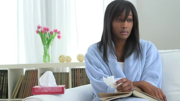 Thumbnail for Sick African American woman looking at camera