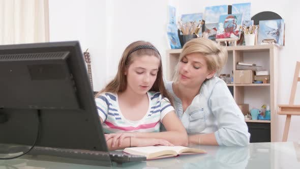 Cover Image for Teenage Girl Reading To Her Mom From a Book