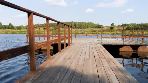 Thumbnail for Wood pier above the river