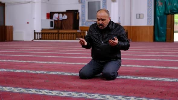 Old Man Raising Hands Praying Mosque
