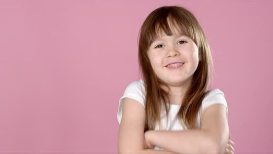 Thumbnail for Adorable 6 Year Old Cute Blonde Girl Posing Isolated in Studio
