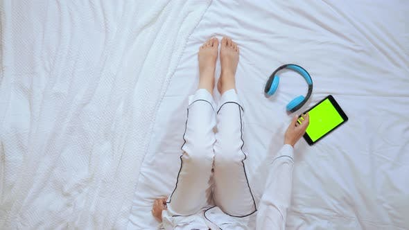 Thumbnail for Above View Girl Using Gadget and Headphones in Apartment