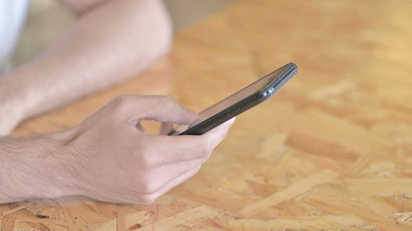 Thumbnail for Close Up of Hands Texting on Smartphone