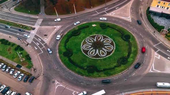 Thumbnail for Aerial View Timelapse of Roundabout Road with Circular Cars in Small European City