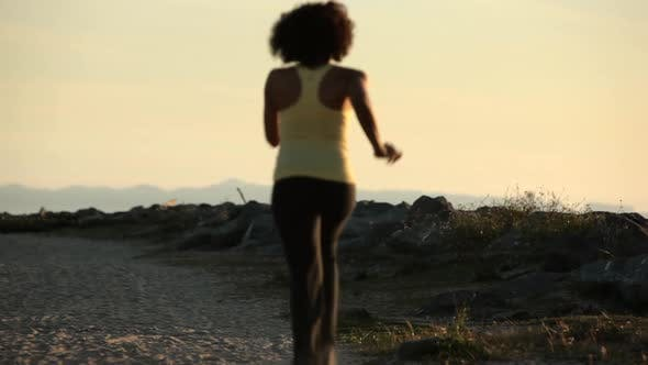 Thumbnail for Young woman running on the beach