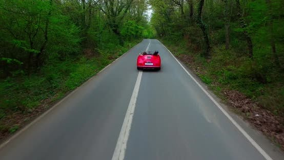 Cover Image for Red Vintage Car And Road Drone View