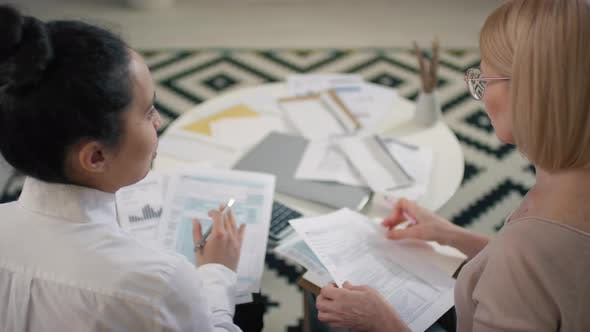 Financial Advisor Helping To Plan Budget