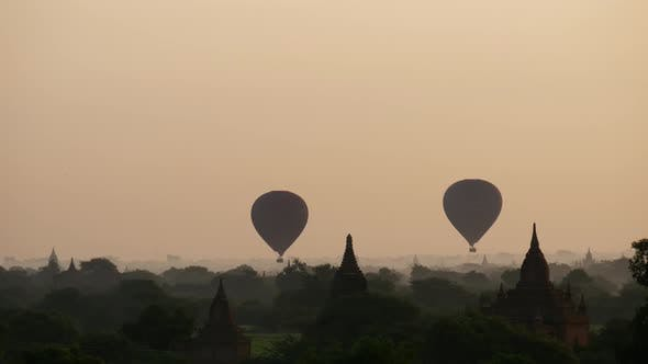 Thumbnail for Balloons flying during sunrise over the Pagodas in Bagan