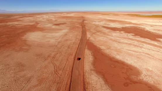 Thumbnail for Red Off-road Vehicle Rides Across Breathtaking Remote Landscape.
