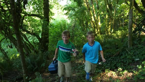 Thumbnail for Two boys walking through woods with fishing gear
