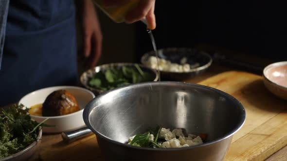 Pouring Olive Oil on Salad with Cherry Tomato and Rukkola Slow Motion Video