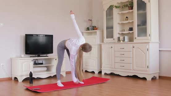 Thumbnail for Girl doing warm-up torso twist exercise before practicing yoga. Healthy lifestyle concept