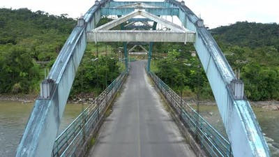 A metal truss bridge, driving over the bridge while the sun comes out