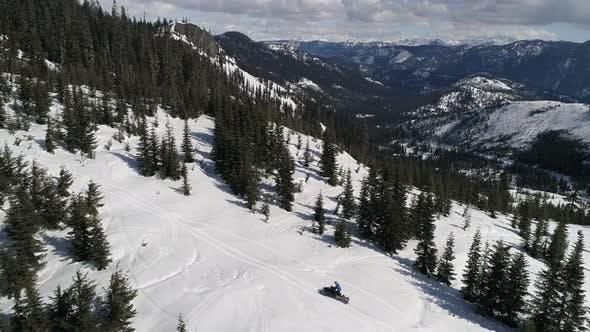 Thumbnail for Man Riding Snowmobile on Scenic Mountain Ridge