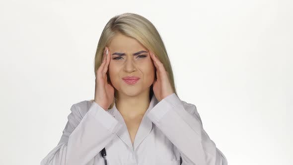 Thumbnail for Young Female Doctor Having Headache. White