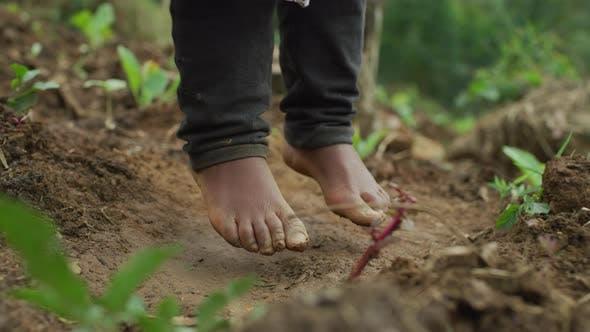 Barefoot child jumping