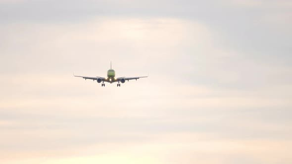 Small Regional Airliner on Final Approach at Sunrise