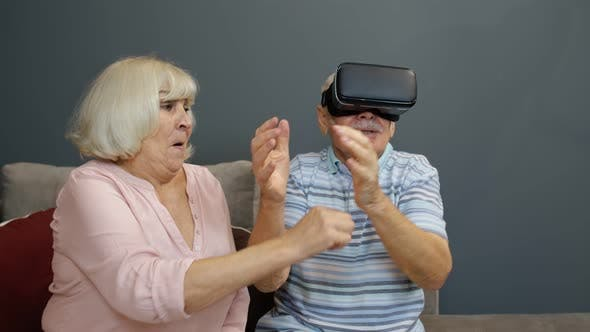 Thumbnail for Senior Man Playing Game in Virtual Reality Headset Glasses, Woman Laughing with Him Action at Home